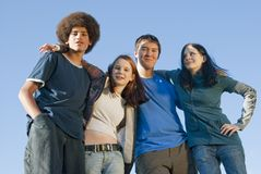 Ethnic teen friends. Teens of various ethnic backgrounds outdoors in the autumn royalty free stock image