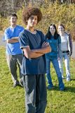 Ethnic teen friends. Teens of various ethnic backgrounds outdoors in the autumn. Focus on boy in front Royalty Free Stock Photography