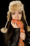 Ethnic teen girl wearing a winter hat and scarf. Ethnic teen girl wearing winter hat and scarf with her hand and scarf covering part of her mouth Stock Photos
