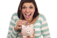 Ethnic Teen Putting Coin Into Piggy Bank on White Stock Images