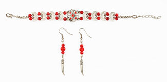 Ethnic Tibetan bracelet ear rings with red beads Royalty Free Stock Images