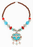 Ethnic Tibetan necklace with yak symbol Stock Images