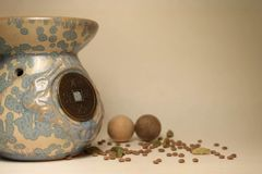 Ethnic vase in the style of Feng Shui. Chinese blue old ethnic vase in Feng Shui style with coin on light background Stock Image