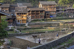 Ethnic village in China mountainous terrain, wooden houses at su Royalty Free Stock Image