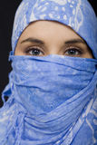 Ethnic woman. Ethnic blue eyes woman on black isolate portrait Royalty Free Stock Image