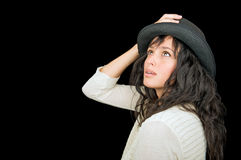 Ethnic woman on black background. Beautiful ethnic woman wearing a hat on black background with room for text Royalty Free Stock Photography
