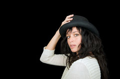 Ethnic woman on black background. Beautiful ethnic woman wearing a hat on black background with room for text Stock Photo