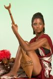 Ethnic woman chief with spear and other artifacts Royalty Free Stock Image