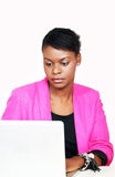Ethnic woman on computer Royalty Free Stock Images