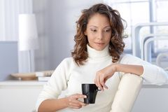 Ethnic woman drinking coffee at home Royalty Free Stock Images