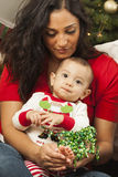 Ethnic Woman With Her Mixed Race Baby Christmas Portrait stock image
