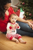 Ethnic Woman With Her Newborn Baby Christmas Portrait Stock Image