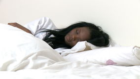 Ethnic woman waking up slowly stock video