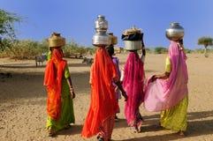 Ethnic women on the desert stock photography