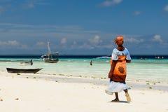Ethnic women on sandy beach, Africa Stock Photo