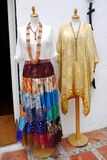 Ethnic Womenswear Summer. Two mannequins standing on the sidewalk, dressed with summer womenswear as a gypsy skirt and a silken pancho Stock Photo