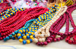 Ethnic wooden multicolored necklaces at market Royalty Free Stock Images