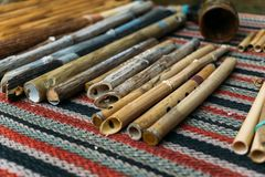 Ethnic woodwind flutes, wooden musical instruments handmade Stock Photos