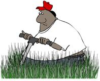 Ethnic worker mowing tall grass Royalty Free Stock Photos