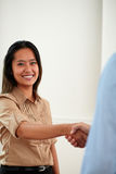 Ethnic young businesswoman giving hands greeting Stock Image