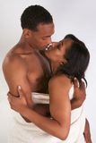 Ethnic young couple wrapped in white bath towel Royalty Free Stock Photography