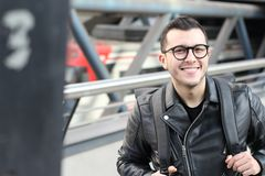 Ethnic young man smiling in underground station royalty free stock images