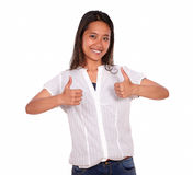 Ethnic young woman smiling and showing you ok sign Stock Photography