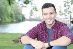 Ethnically ambiguous male smiling with copy space Royalty Free Stock Photo