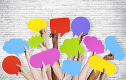 Ethnicity Human Arms Speech Bubble by Brick Wall Concept.  Royalty Free Stock Image