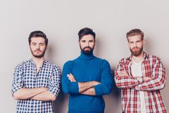 Ethnicity, multicultural diversity. Three serious harsh men are. Standing isolated on pure background with crossed hands, dressed in casual clothes stock images