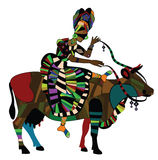 Ethnics. Woman in the ethnic style on the back of a cow Stock Photo