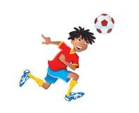 Ethnischer Junge, der Fußball spielt Lizenzfreies Stockfoto