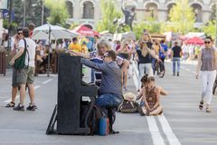 Ethno-fest : traditions - emotions - life. Man and woman at the piano on the street of Kiev during the festival, Ukraine Stock Photo