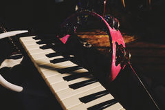 Ethno music set on the stage. Pink tambourine and piano keybord laying in the case on the stage before the performance event royalty free stock image