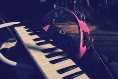 Ethno music set on the stage. Pink tambourine and piano keybord laying in the case on the stage before the performance event stock photo