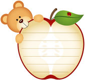 Etichetta con Teddy Bear Eating Apple Fotografie Stock Libere da Diritti