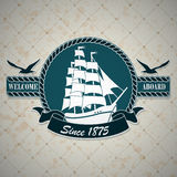 Etichetta d'annata con un tema nautico Immagine Stock Libera da Diritti