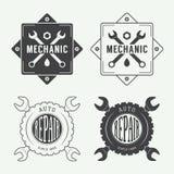 Etichetta d'annata, emblema e logo del meccanico Immagini Stock