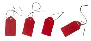 Etichetta dal feltro di rosso Collage delle etichette del regalo isolate su fondo bianco Fotografia Stock