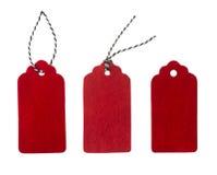 Etichetta dal feltro di rosso Etichette del regalo, isolate su fondo bianco Fotografia Stock Libera da Diritti