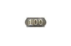 Etichetta del metallo con il numero 100 Immagine Stock Libera da Diritti