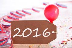 Etichetta del partito con la fiamma ed il pallone, testo 2016 Fotografie Stock