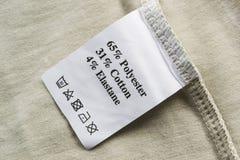 Etichetta della composizione nel tessuto fotografia stock