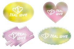 Etichetta di amore sul fondo del pastello della sfuocatura Fotografia Stock
