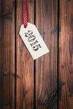 Etichetta di Buon Natale su superficie di legno Fotografia Stock Libera da Diritti