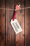 Etichetta di Buon Natale su superficie di legno Fotografie Stock