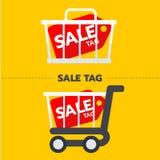 Etichetta di vendita con l'etichetta di promozione del carretto e del canestro Concetto online di acquisto Fotografia Stock