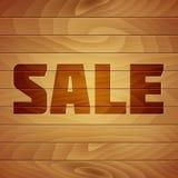 Etichetta di vendita dell'ustione su struttura di legno Fotografie Stock
