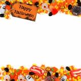 Etichetta felice di Halloween con il confine del doppio della caramella sopra un fondo bianco Immagini Stock Libere da Diritti