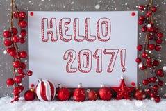 Etichetta, fiocchi di neve, palle di Natale, testo ciao 2017 Fotografia Stock